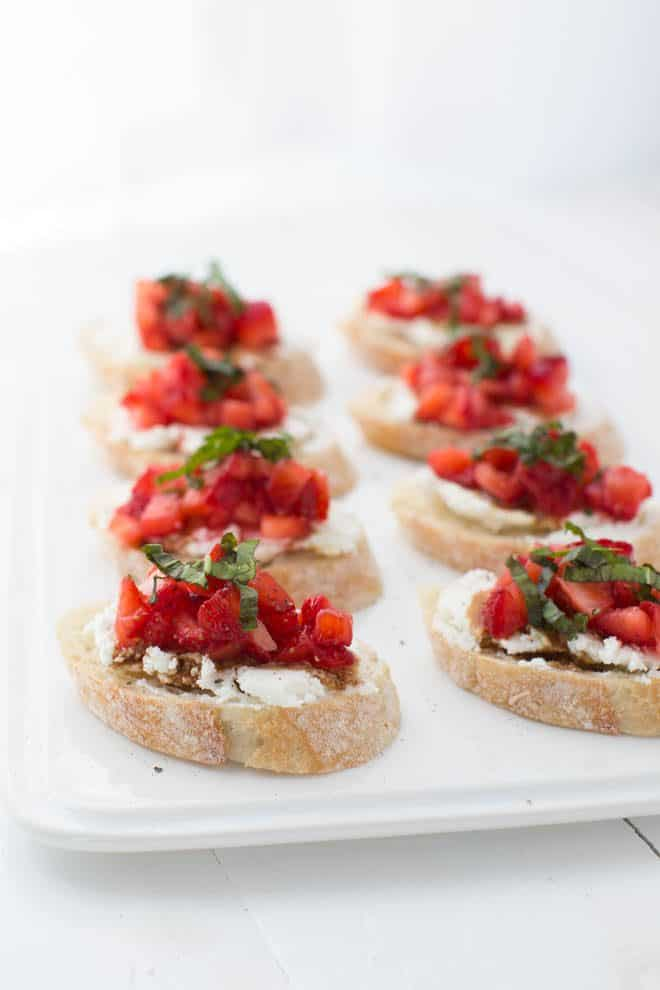 Strawberry Bruschetta is a simple, elegant and impressive appetizer or light lunch option! Pile fresh strawberries on top of crusty bread with goat cheese and drizzle with olive oil and balsamic vinegar.