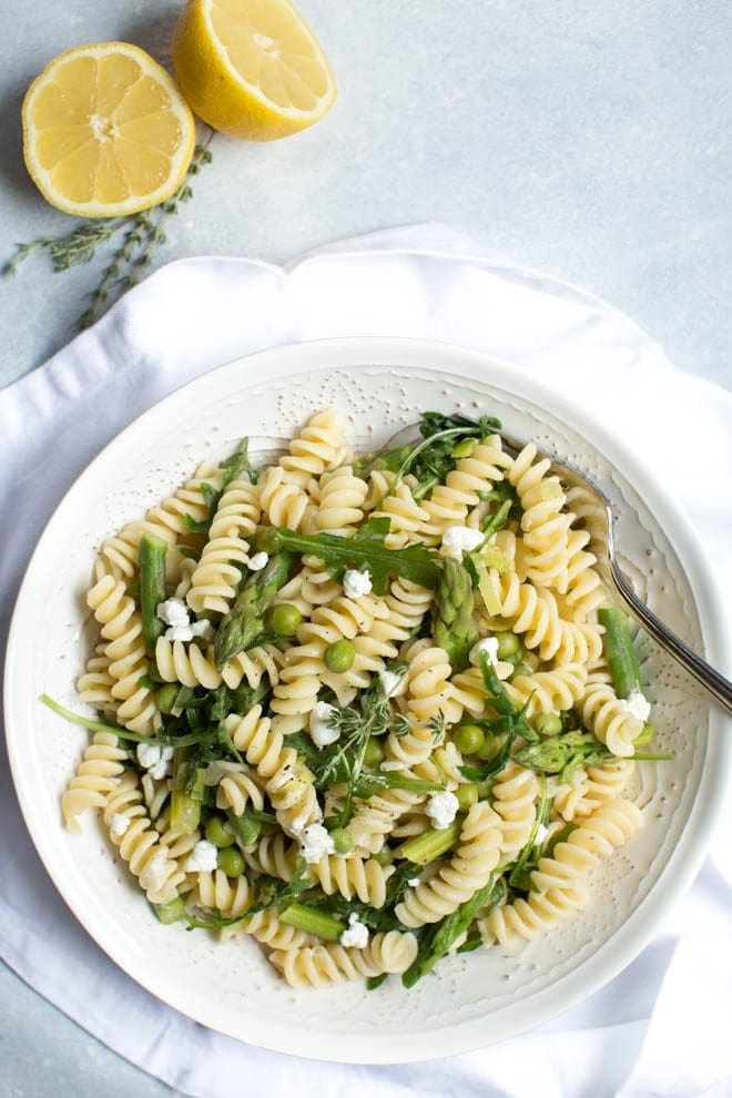 Fusilli with Asparagus, Peas and Arugula is a simple recipe that is packed with the freshest flavors! Enjoy this healthier meal all year long.