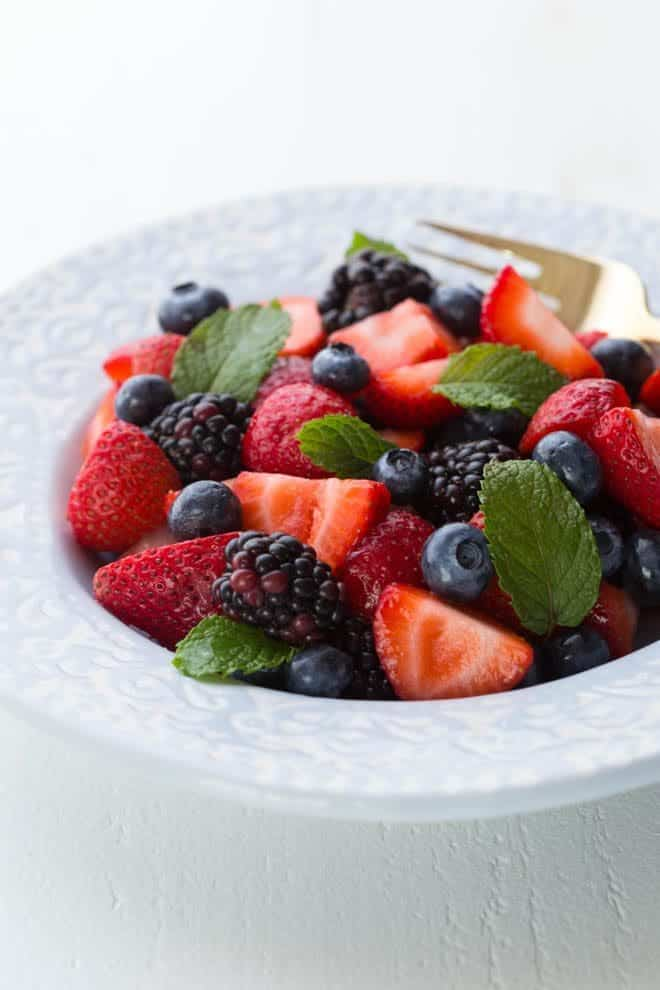 Triple Berry Salad is made with strawberries, blueberries, blackberries and a simple honey-mint lemon glaze!