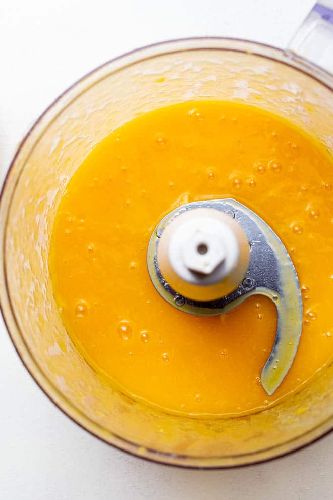 Mango puree in a food processor.
