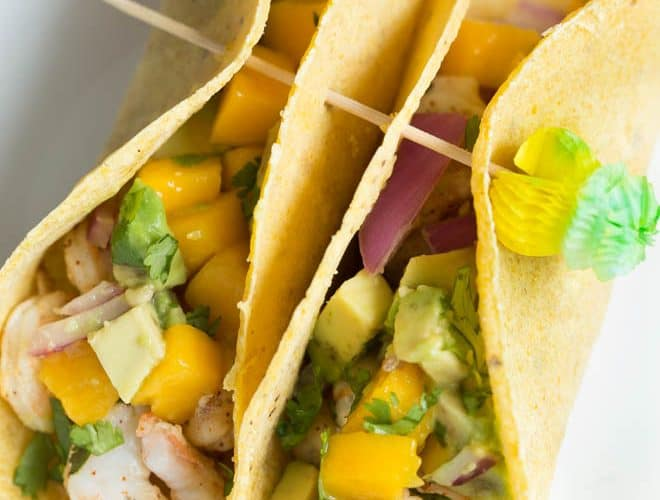 Shrimp Tacos with Mango Avocado Salsa are a quick, fresh and easy meal for lunch or dinner! Lightly seasoned grilled shrimp are topped with a homemade mango avocado salsa to create a meal kids and adults will love.