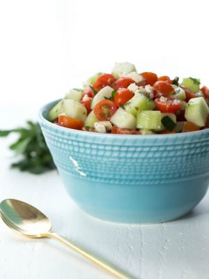 Cucumber and Tomato Salad is a simple side dish made with fresh tomatoes, cucumber, feta cheese and more!