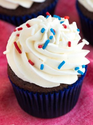 Simple chocolate cupcakes with vanilla buttercream are a favorite classic cupcake recipe! Impress your guests with this simple chocolate cake and sweet buttercream frosting.