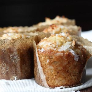 Banana Coconut Crunch Muffins are a fun twist on a classic banana muffin recipe! They are made with walnuts, granola and shredded coconut.