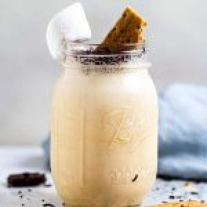 A large glass of s'mores milkshake recipe.