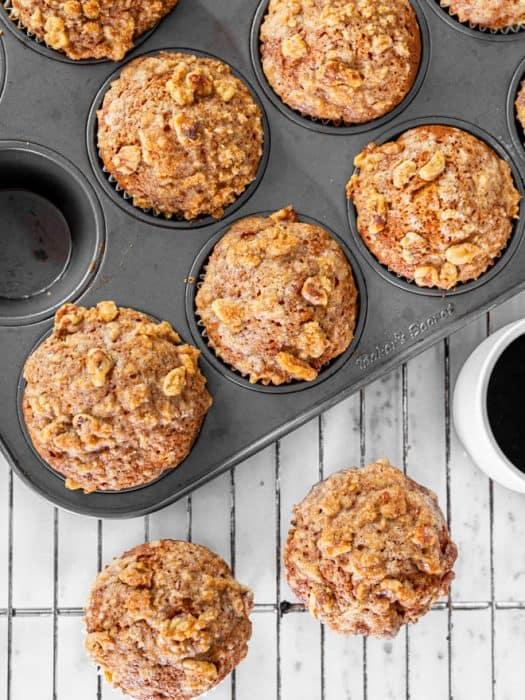 Pumpkin muffins in a baking pan.