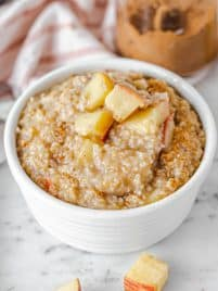 apple steel cut oatmeal in a bow with chopped apples on top