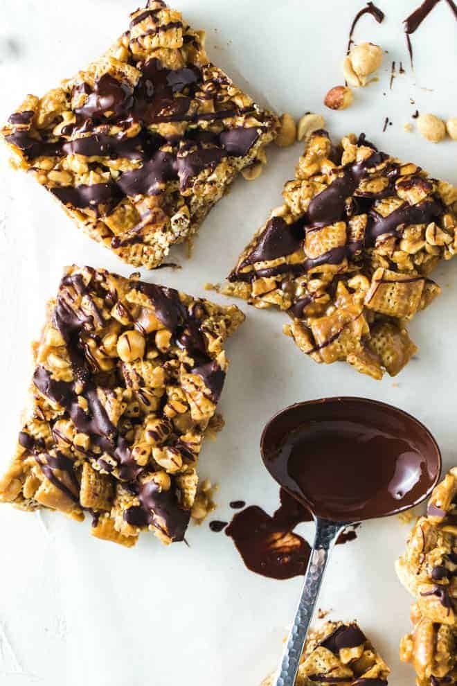 Three cereal bars drizzled with chocolate.
