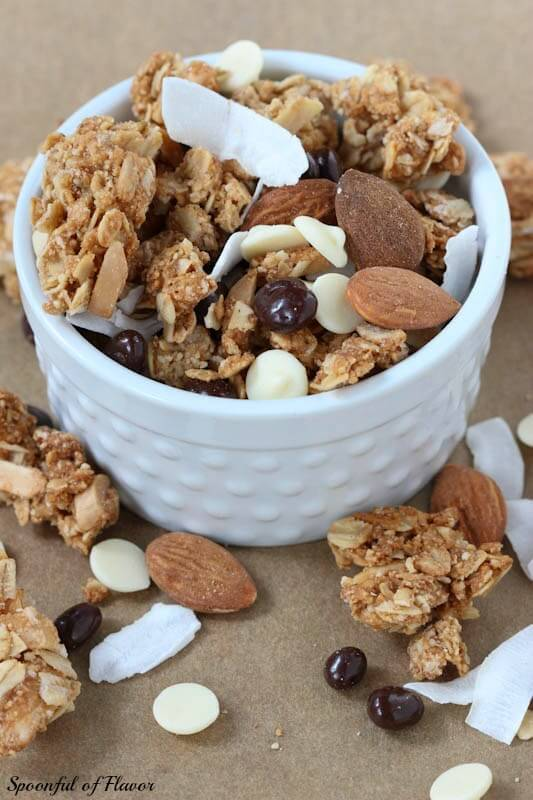 Granola Trail Mix - Chunks of granola combined with almonds, coconut, white chocolate and chocolate covered pomegranate seeds!