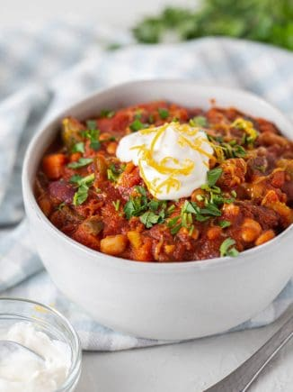 vegetarian bean chili in a bowl with sour cream on top