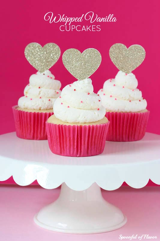 Whipped Vanilla Cupcakes - the prettiest little cupcakes with a whipped vanilla frosting!