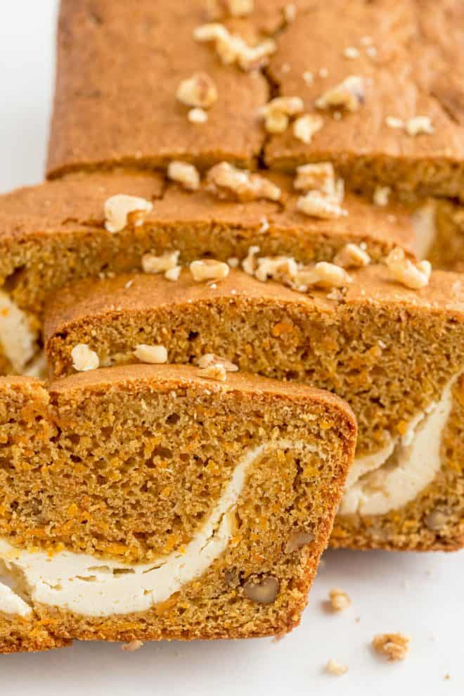 slices of carrot loaf with nuts on top