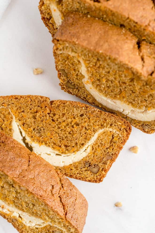 slices of carrot loaf cut on a white counter