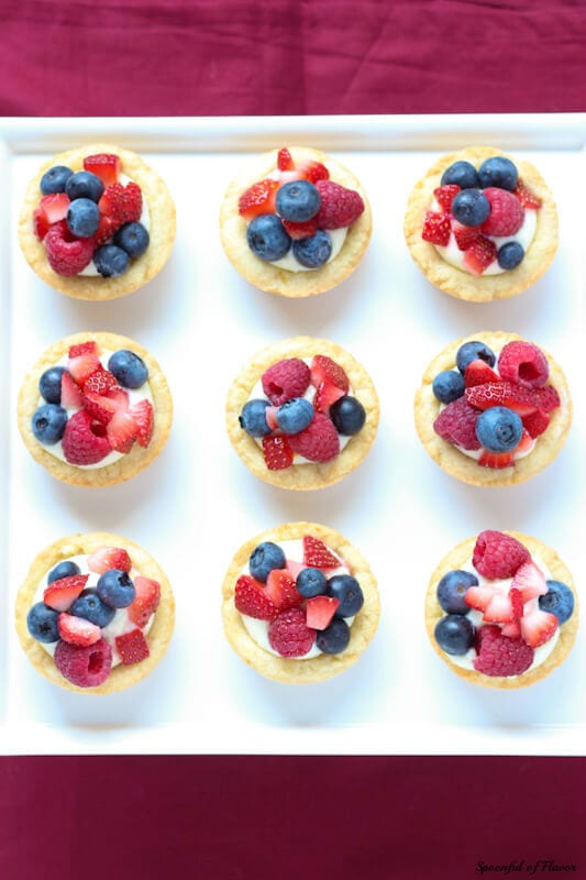 Triple Berry Lemon Cookie Cups - fresh lemon cream and berries sits on top of a delectable lemon sugar cookie crust! The perfect mini dessert!