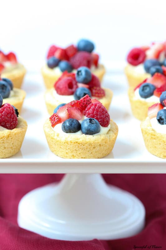 Triple Berry Lemon Cookie Cups - fresh lemon cream and berries sits on top of a delectable lemon sugar cookie crust! The perfect little individual sized dessert!