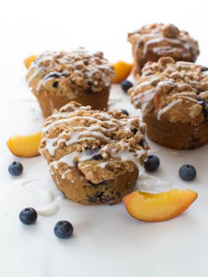 Blueberry Peach Cobbler muffins are perfect for the summer season! This recipe makes jumbo sized muffins full of juicy peaches and ripe blueberries!
