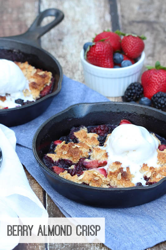 Triple Berry Almond Crisp - loaded with fresh berries and almond topping! Baked in mini skillets and served with ice cream!