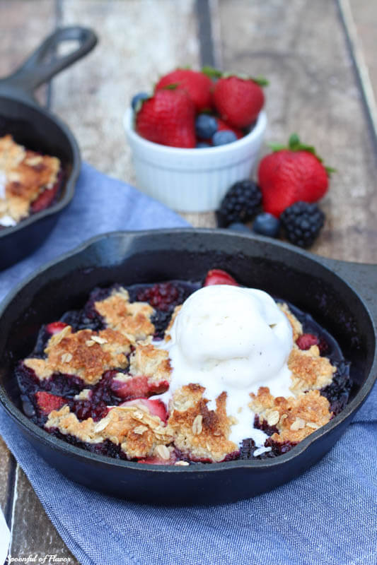 Triple Berry Almond Crisp - loaded with fresh berries and almond topping! Eat it for breakfast with yogurt or with a scoop of ice cream for dessert!