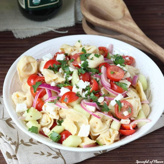 Tortellini Pasta Salad - fresh, easy and the perfect way to use up your garden veggies! With tomatoes, onions, cucumbers and feta!