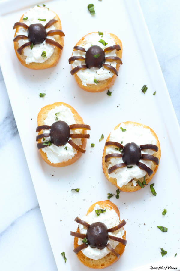 Spider Bites - Crostini with whipped feta and olives are the perfect after school snack!