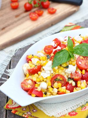 Sautéed Corn Basil and Feta Salad is the perfect side dish for summer! #summer #sidedish #corn #recipe #salad