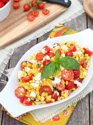 Sautéed Corn with Tomatoes, Feta and Basil is the perfect side dish with plenty of savory flavors