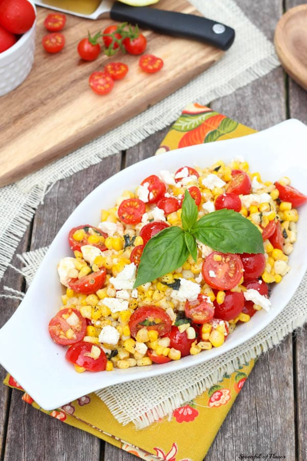 Sauteed Corn with Basil and Tomatoes - the perfect side dish with plenty of savory flavors!
