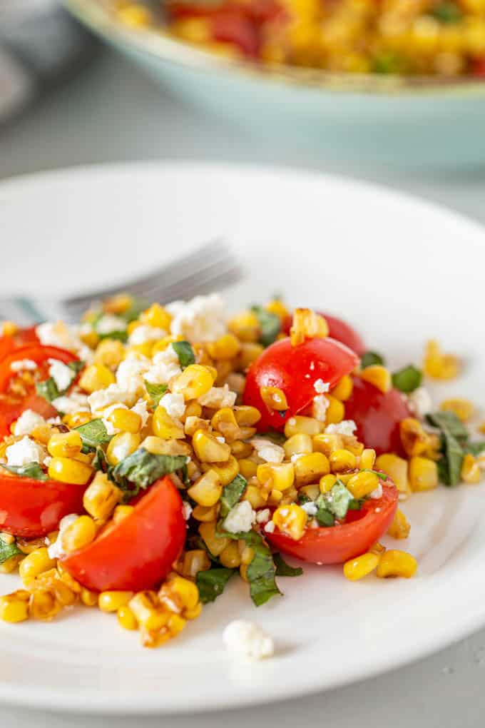 sauteed corn with tomatoes on a plate