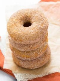 a stack of four baked pumpkin donuts