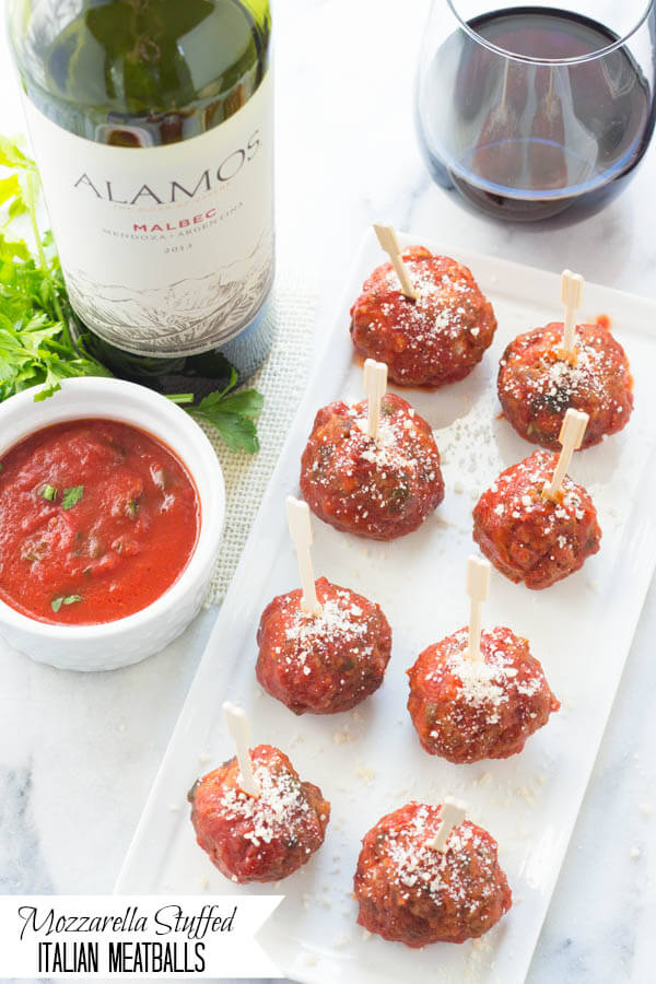 Mozzarella Stuffed Baked Italian Meatballs are perfect for the holidays, dinner parties or game days!