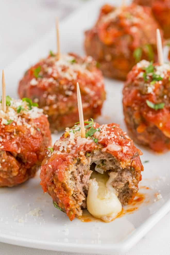 cheese oozing out of a meatball