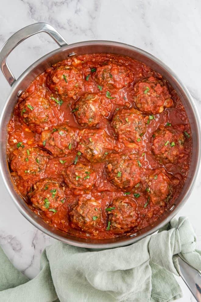 cooked mozzarella stuffed meatballs in a skillet