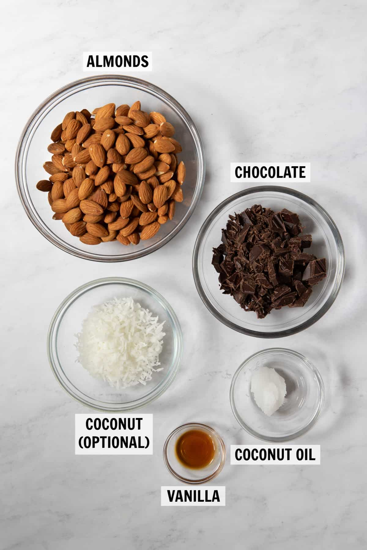 all of the ingredients for coconut clusters on a white countertop