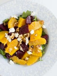 roasted beets, oranges, cheese and nuts in a salad