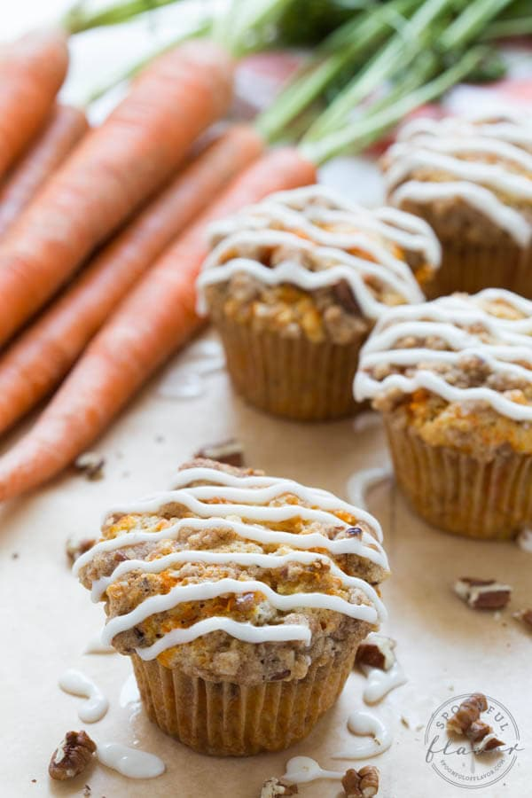 Carrot Coffee Cake Muffins with Cream Cheese Icing is the perfect treat for brunch or snack! With a cinnamon streusel and crunchy pecans you won't be able to resist these muffins!