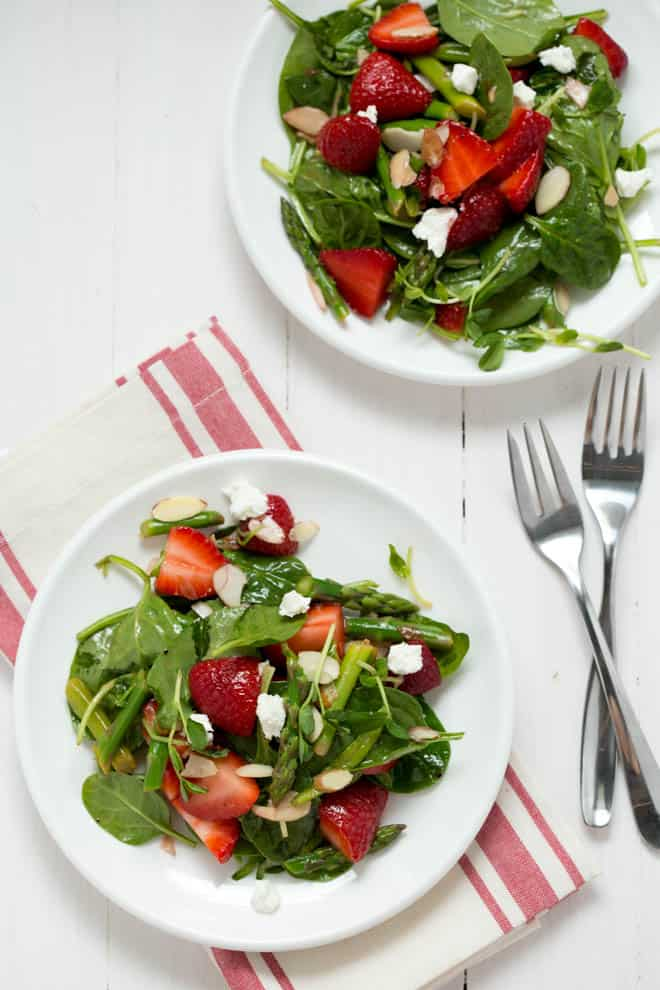 Two plates of strawberry spinach salad.