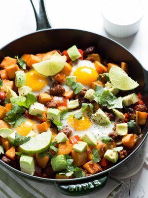 Chorizo Breakfast Hash with Sriracha Honey Lime Sour Cream! Start the day the right way with fresh veggies, eggs and more!