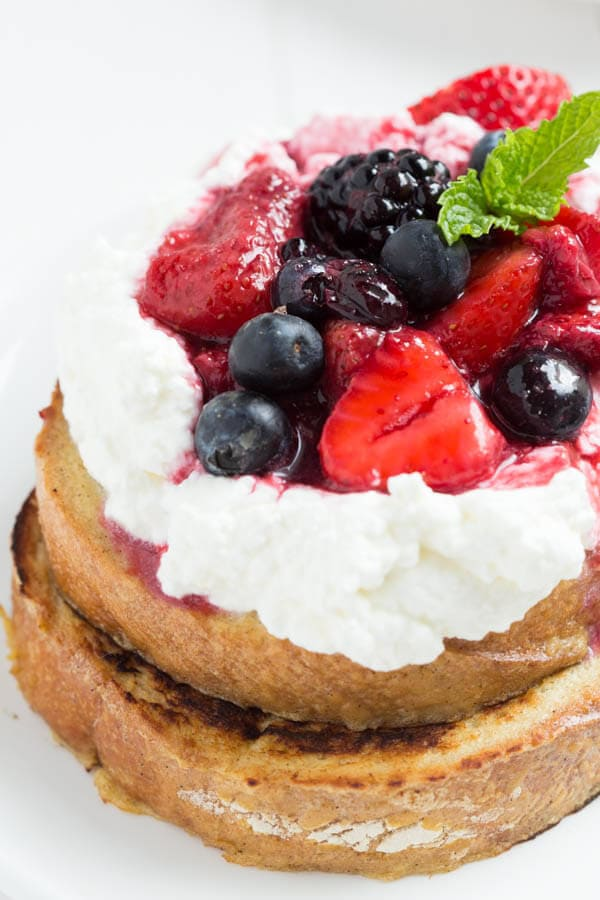 Cinnamon Yogurt French Toast with Whipped Lemon Yogurt Topping and Mixed Berries - perfect for breakfast or brunch!