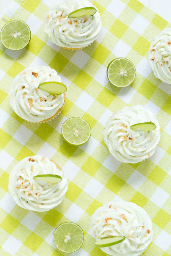 Coconut Cupcakes are stuffed with coconut filling and topped with key lime buttercream frosting! These cupcakes are too good to resist!