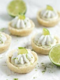 No Bake Mini Key Lime Pies - a layer of crust is filled with key lime filling and topped with whipped coconut cream! These little bites pies are gluten free, vegan, paleo and healthy!