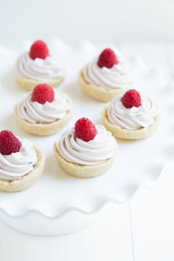 No Bake Raspberry Lemon Cookie Cups are a gluten free, dairy free, and vegan dessert! Made with coconut, lemon, raspberries and a few simple ingredients.