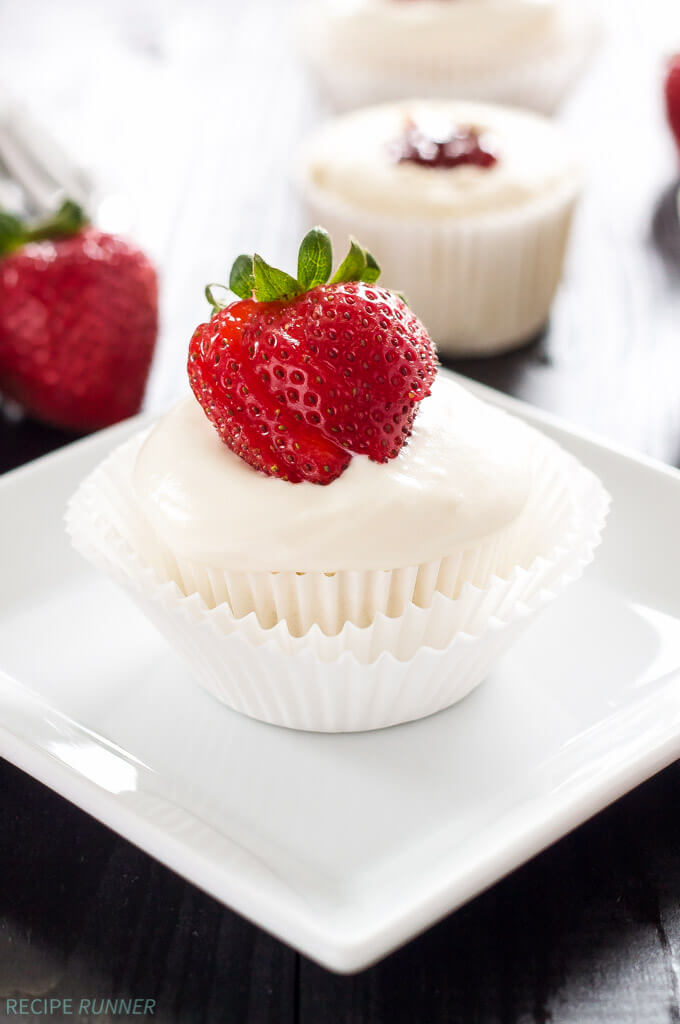 Strawberry Filled Angel Food Cupcakes | Angel food cupcakes filled with strawberry jam and topped with vanilla whipped cream-cream cheese frosting!