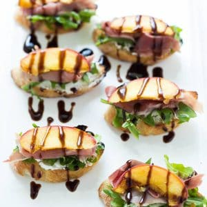 Grilled Peach Crostini with Arugula, Prosciutto and Goat Cheese is the perfect light summer snack, appetizer or lunch!