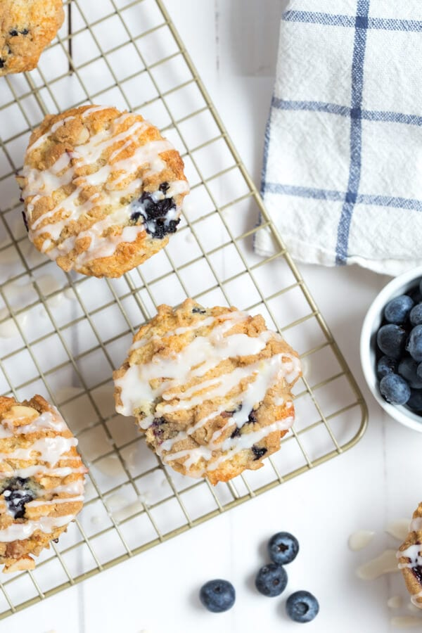 Blueberry Coffee Cake Muffins combine the best of blueberry muffins and coffee cake muffins with a sugar drizzle!
