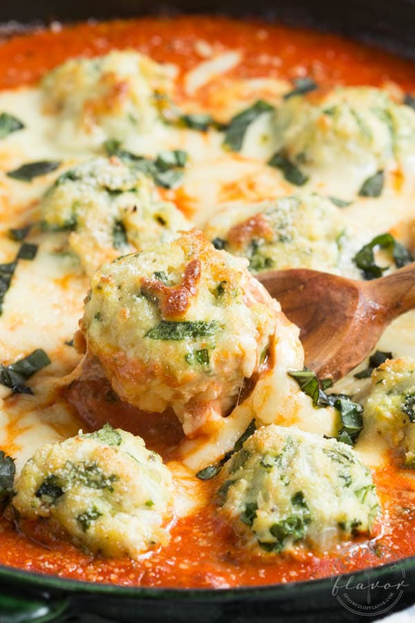 Spinach Chicken Parmesan Meatballs are baked in a creamy tomato sauce to create a meal that everyone will love!