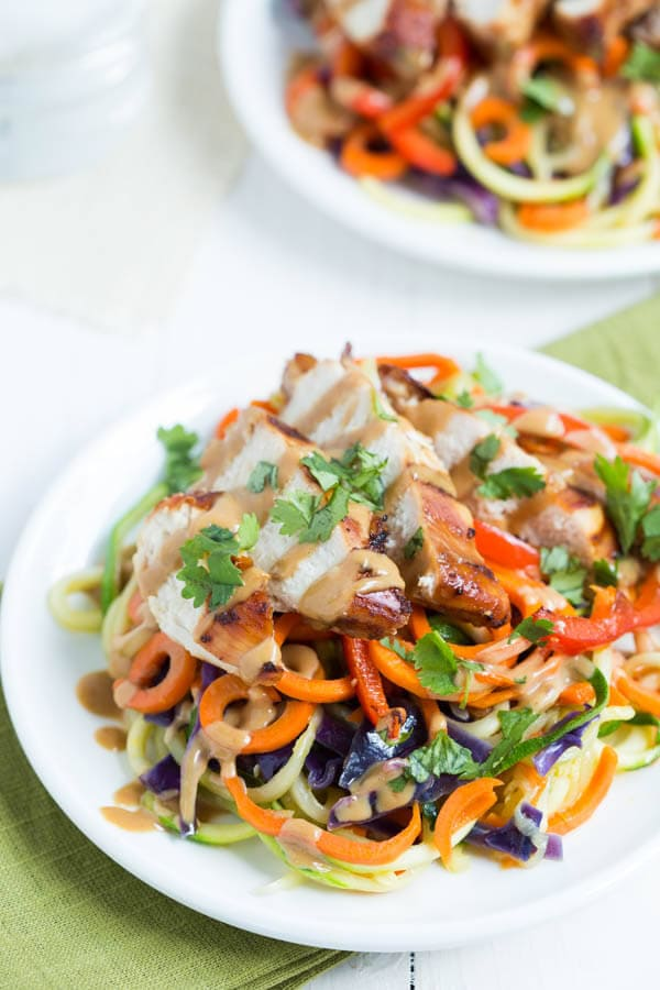 Thai Chicken Noodles with zucchini noodles, carrot noodles, cabbage, red bell pepper, soy-ginger chicken and peanut dressing!