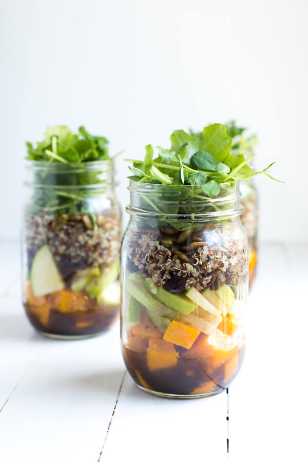 Fall Mason Jar Salad with Maple Balsamic Dressing includes roasted butternut squash, apples, dried cranberries, quinoa, toasted pumpkin seeds, and fresh greens!