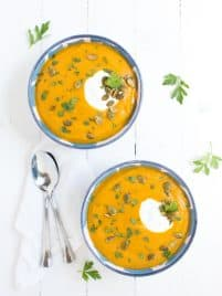 Roasted Butternut Squash and Red Lentil Soup is made with fresh, healthy ingredients and is garnished with Greek yogurt, pepitas and parsley!