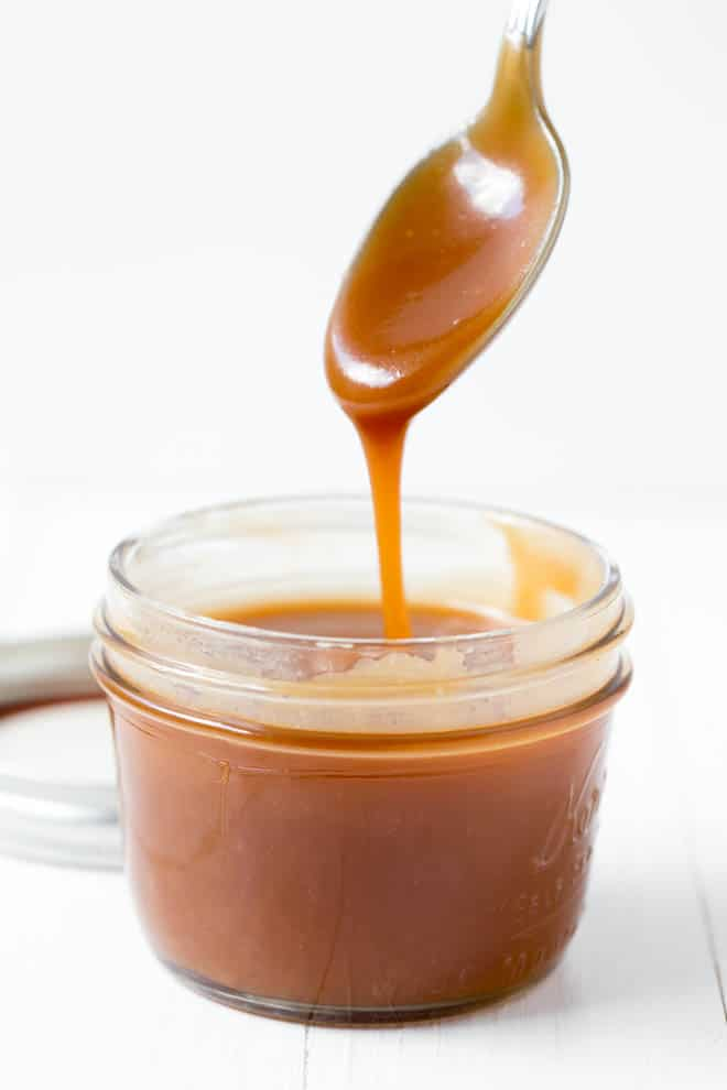 Drizzle of caramel sauce into a jar.