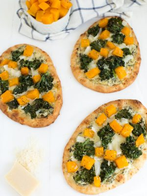 Roasted Butternut Squash, Kale & Spinach Flatbread is a delicious snack, appetizer or light meal. Made with spinach and kale dip, naan bread, fresh kale, roasted butternut squash and more!